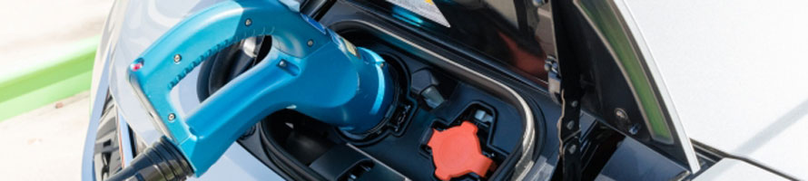 Electric car charging representing the battery industry and its battery cathode materials