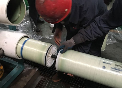 Engineer installing a filtration membrane for Sulfate or sulphate removal